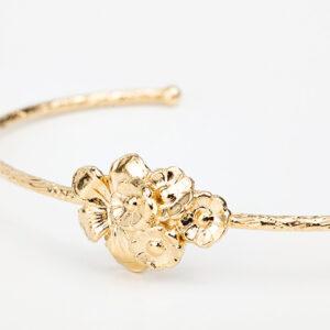 Bracelet Mélissa en or fin, fleurs, fond blanc collections création bijoux Laparitaine